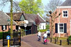 Women are cycling in the ancient Kerkebuurt (Church district) in Soest, Netherlands Stock Images