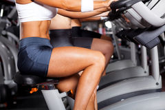 Women cycling in gym. Group of women cycling in gym Royalty Free Stock Images
