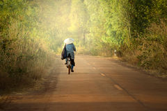 Women cycling on the road. Asian Backside vietnam woman cycling Royalty Free Stock Image