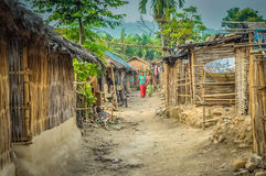 Women in Damak. Photo of two women walking between huts in Nepali refugee camp in Damak, Nepal stock photo