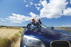 Women dance in car Stock Photos