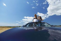 Women dance in car Royalty Free Stock Photos