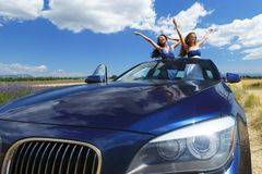 Women dance in car Royalty Free Stock Photo