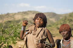 Women dance and sing at the bull jumping ceremony, Ethiopia Stock Photography