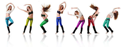 Women dancers. Seven beautiful women dancing on white background Royalty Free Stock Photography