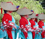 Women dancing. Women wearing traditional straws hats performing a dance dedicated to a wealthy crop,during a Japanese festival.Miyagi,Japan Stock Photo