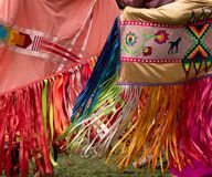 Women Dancing with Colorful Shawls at a Pow Wow. Two Native American women wearing appliqued shawls with colorful ribbon fringe dancing at a pow wow royalty free stock photos