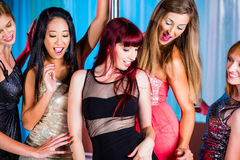 Women dancing in discotheque or club Stock Images