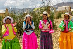Women dancing at the festival of indigenous people in Peru, Titikaka lake, Uros islands