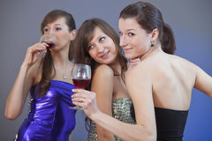 Women dancing with glasses wine royalty free stock photo