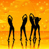 Women dancing on stage. Golden background Royalty Free Stock Images