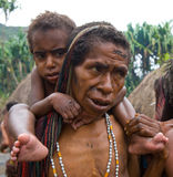 Women Dani tribe with children. Royalty Free Stock Images