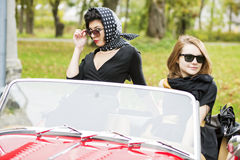 Women with dark glasses behind car windscreen Stock Photos