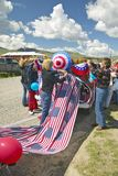Women decorating a car in red, white & blue in Lima Montana Stock Photography