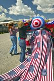 Women decorating a car in red, white & blue in Lima Montana Royalty Free Stock Photos