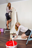 Women decorators posing with their equipment Stock Photo