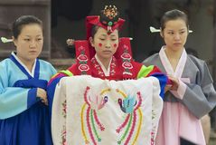 Women demonstrate traditional Korean wedding dress in Yongin, Korea. Royalty Free Stock Photos