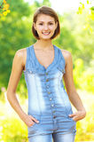 Women in denim overalls with his Royalty Free Stock Photography