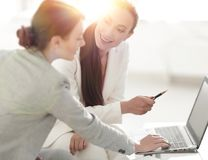Women designer and the client. Women designer with a client working in the office. photo with copy space royalty free stock image