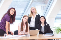 Women at the desk Stock Images