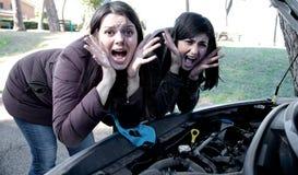 Women desperate about broken car screaming for help. Women unhappy about broken engine Stock Photos