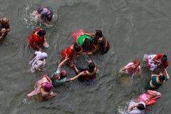 Women devotees take bath in the river Godavari Royalty Free Stock Photo