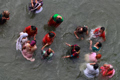 Women devotees take bath in the river Godavari Stock Image