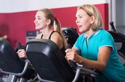 Women of different age training on exercycle Royalty Free Stock Photos