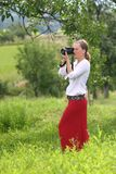 Women with a digital camera. Woman shooting with a digital camera Royalty Free Stock Photo