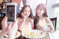 Women dine in restaurant. Beauty women selfie and dine in restaurant Royalty Free Stock Photo