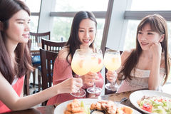 Women dine in restaurant. Beauty women smile and dine in restaurant Stock Photos