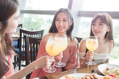 Women dine in restaurant. Beauty women smile and dine in restaurant Stock Photo
