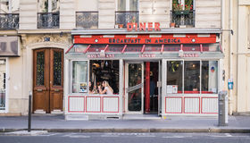 Women diners in Breakfast in America diner in Paris, France. Women companions glimpsed through window of the Breakfast in America diner in Paris, France Stock Photos
