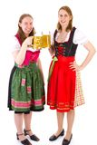 Women in dirndl drinking double beer at bavarian feast Royalty Free Stock Image