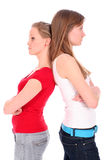 Women disagreeing. Young women standing back to back Stock Photos