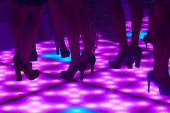 Women in the disco. Detail of legs and feet of young women in the disco royalty free stock images