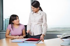 Women Discussing Business Reports Stock Photography