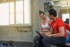 Women are discussing fitness with trainers. Young female talking royalty free stock photography