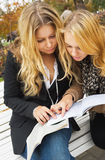 Women discussing homework Stock Images