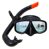 Women diving at ocean is reflected in diving mask and snorkel on the beach Stock Photos