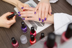 Women do manicure Royalty Free Stock Photos