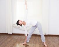 Women do yoga Stock Images