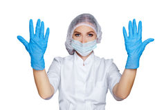 Women Doctor shows hands in sterile gloves isolated on white, Medical advertising concept. Doctor shows hands in sterile gloves isolated on white. Medical Royalty Free Stock Photos