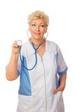 Women doctor with stethoscope looks to right stock photos