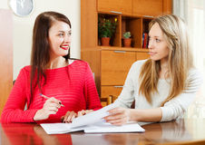 Women with documents at table. In home or office interior stock images