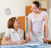Women with  documents at table Royalty Free Stock Photo