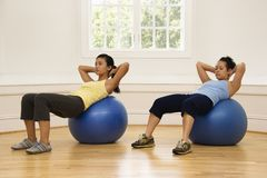 Women doing ab workout royalty free stock images