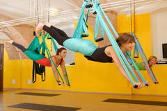 Women doing anti gravity Aerial yoga Stock Photos
