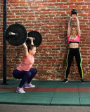 Women are doing cross fit workout at the gym Stock Photos