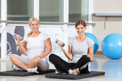 Women doing dumbbell exercises Stock Image